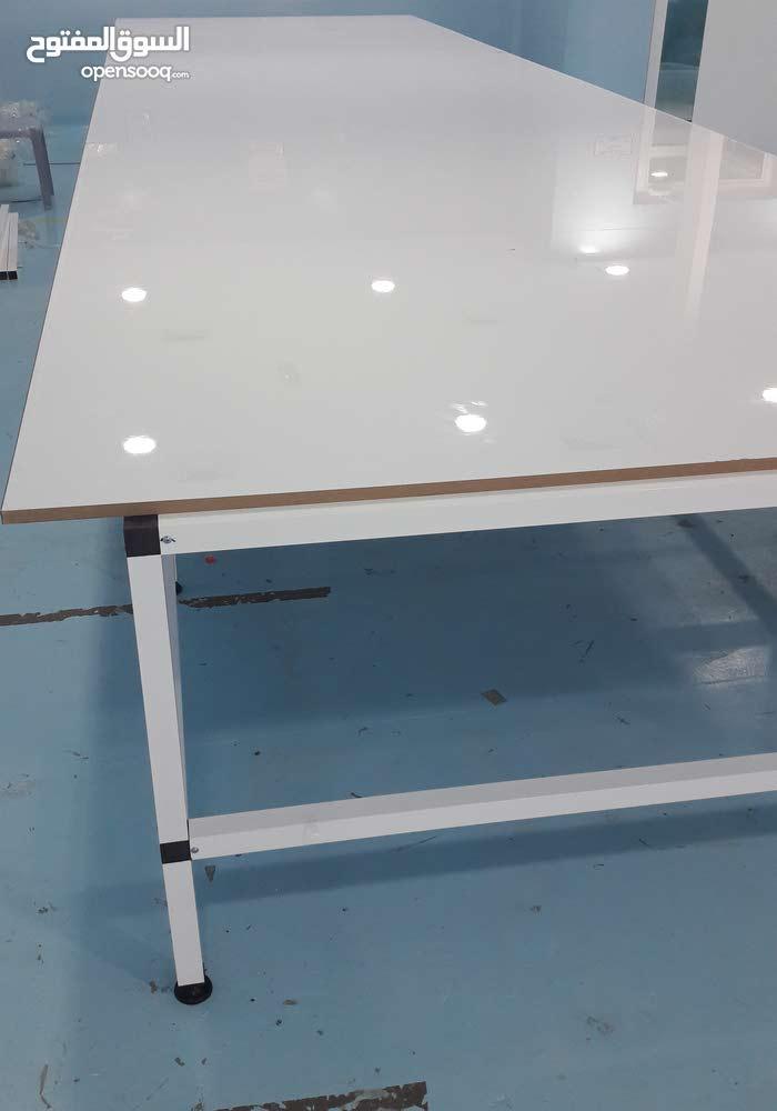 طاولة تفصيل قماش