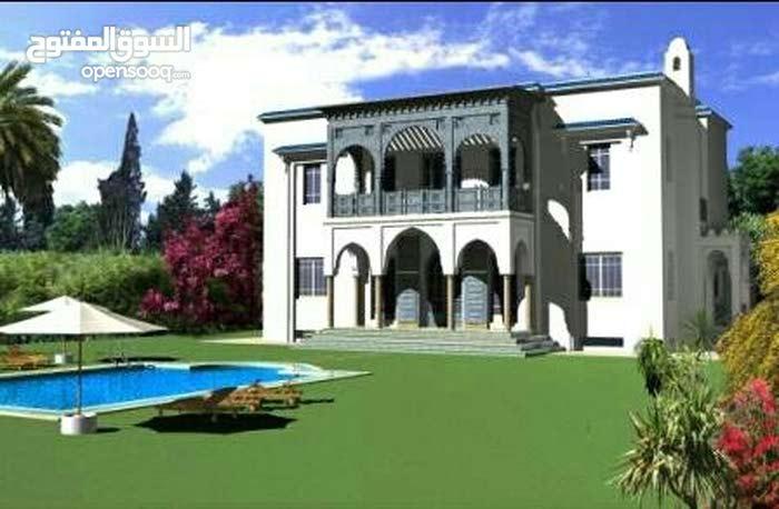 بقعة أرضية لبناء فيلا في حي راق
