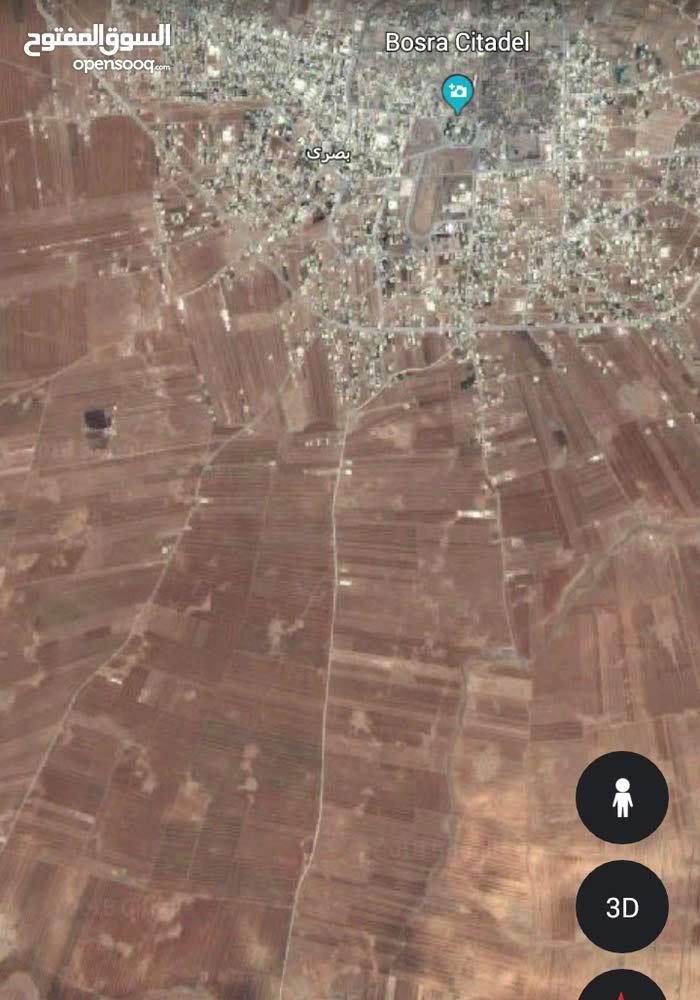 ارض 115دنم ببصرى الشام ع الشارع