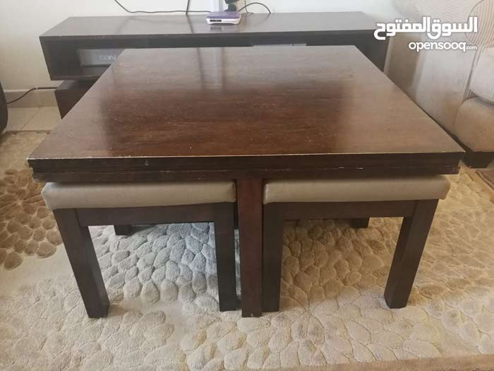 Stupendous Wooden Coffee Table With Hidden Stools Evergreenethics Interior Chair Design Evergreenethicsorg