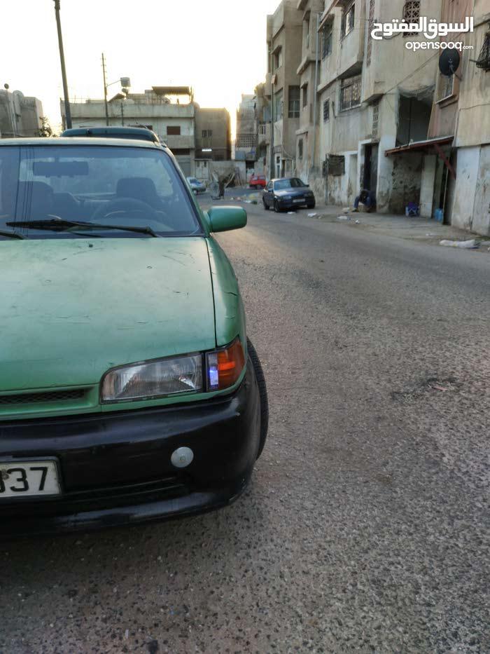 مازدا فاملي 323 . موديل 1990 السيارة