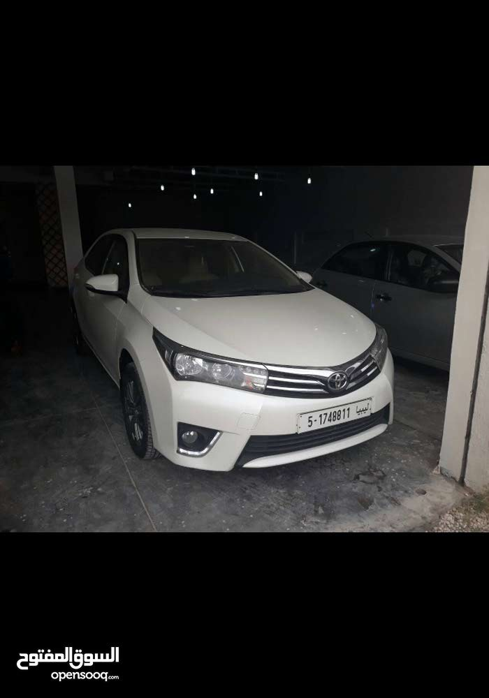 For sale 2014 White Corolla