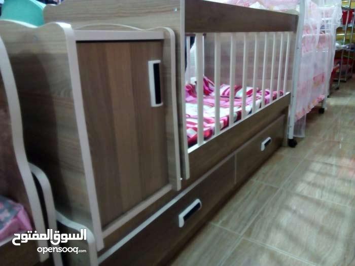 سرير هزاز للأطفال