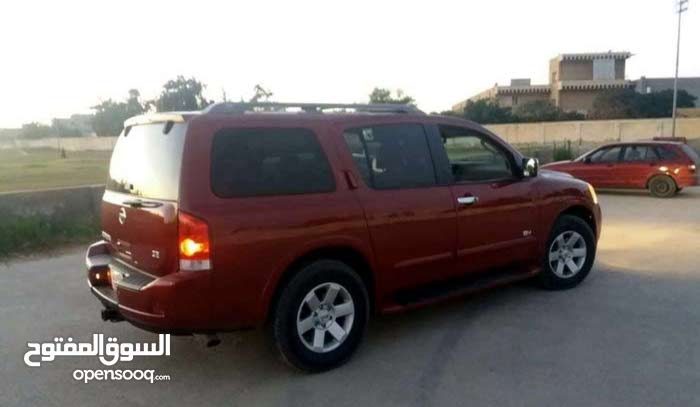Automatic Red Nissan 2010 for sale