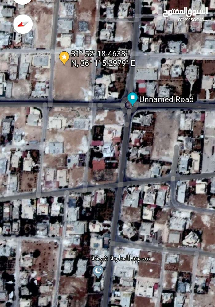 أرض للبيع  على شارعين في منطقة سحاب بالقرب من منزل الشيخ منور - الحي الشرقي
