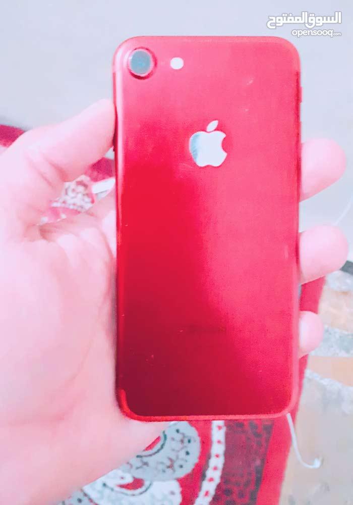 ايفون 7 احمر ذاكرة  128 فقط مقطورة بلازمة