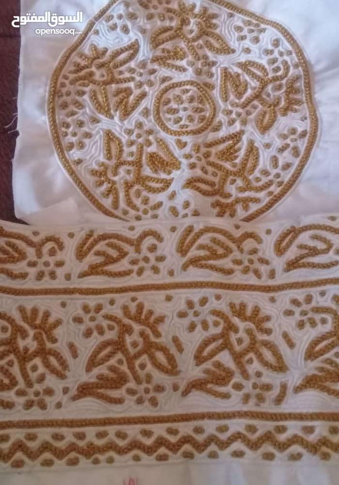 كمة عمانية خياطة يد
