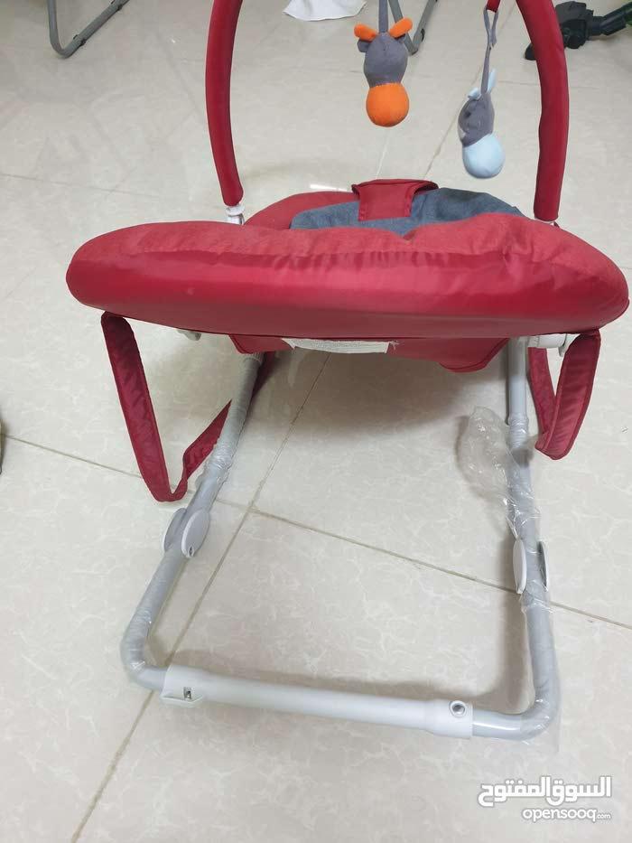 عربة طفل اضافه الى كرسي هزاز