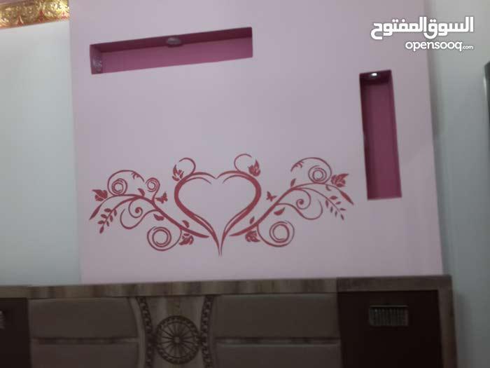 رسم ديكور علي جدران