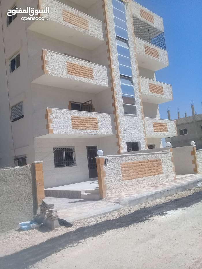 شقة للبيع منطقة الهاشمية بالقرب من مركز امن الهاشمية