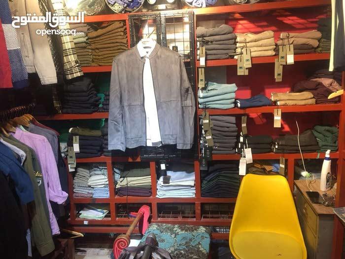 ديكور محل ملابس لبيع