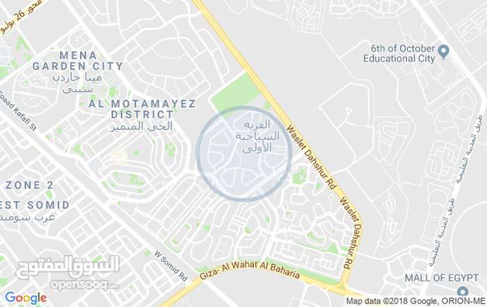 للبيع قطعة ارض 860 متر بالقرية السياحية الاولي امام مول العرب 6اكتوبر