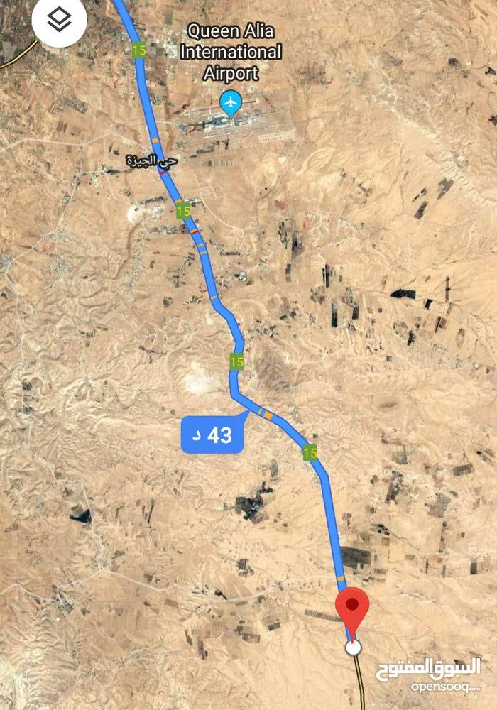 للبيع ارض 11 دونم في جنوب عمان على شارع 100