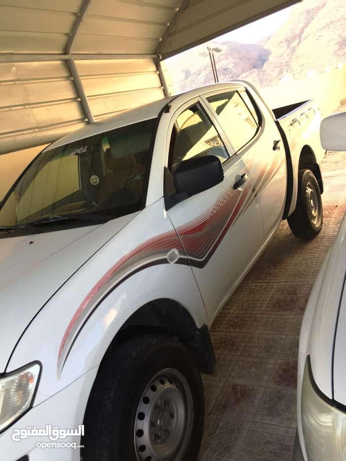 Mitsubishi Pickup 2011 For sale - White color