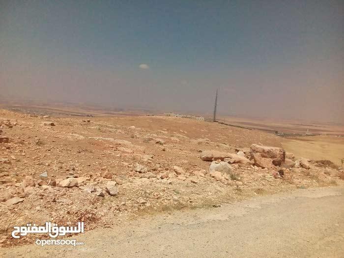 قطعة أرض مميزة للبيع قرب اسكان العاملين بجامعة اليرموك /الحصن