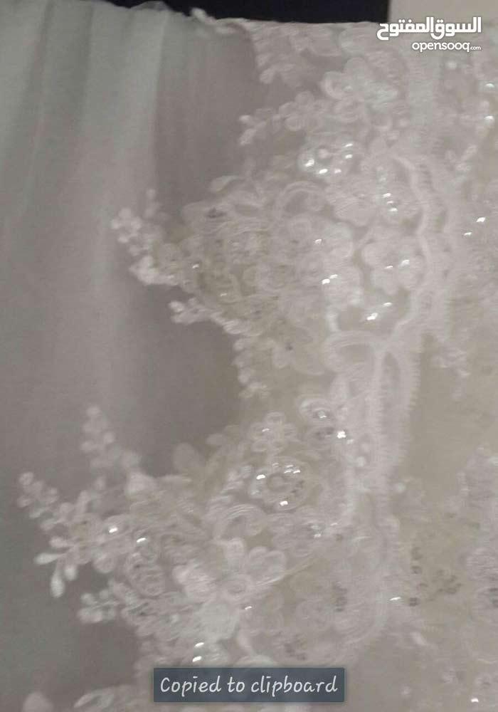 فساتين خطبة واعراس ومع كل فستان جكتات وطرحة مع فستان الزفاف
