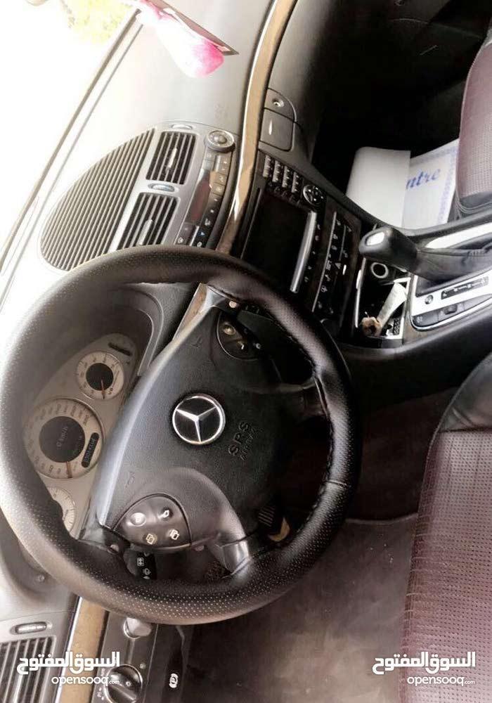 km Mercedes Benz E55 AMG 2004 for sale