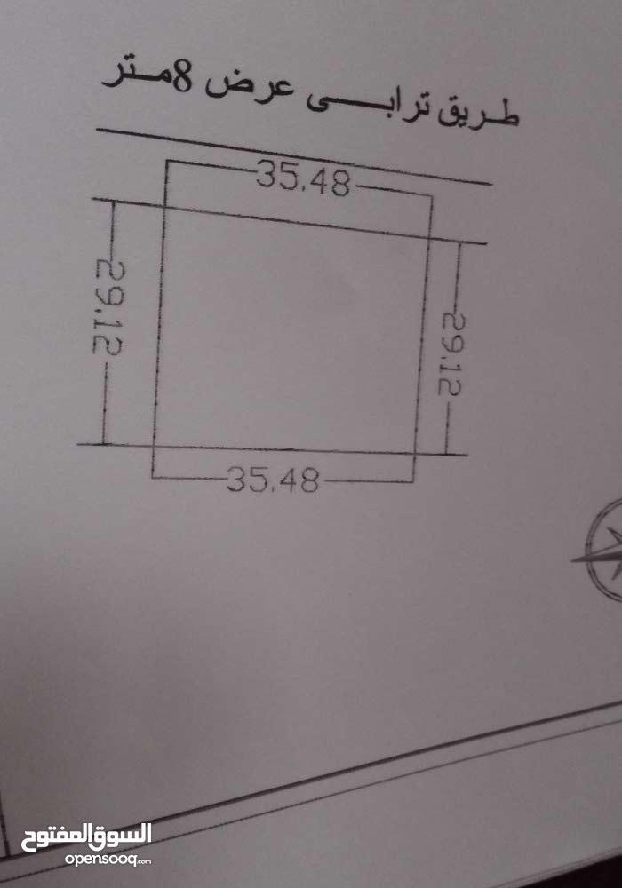ارض للبيع 1033متر مربعة الشكل  بتاجوراءتبعد 25كيلو متر عن طرابلس العاصمة