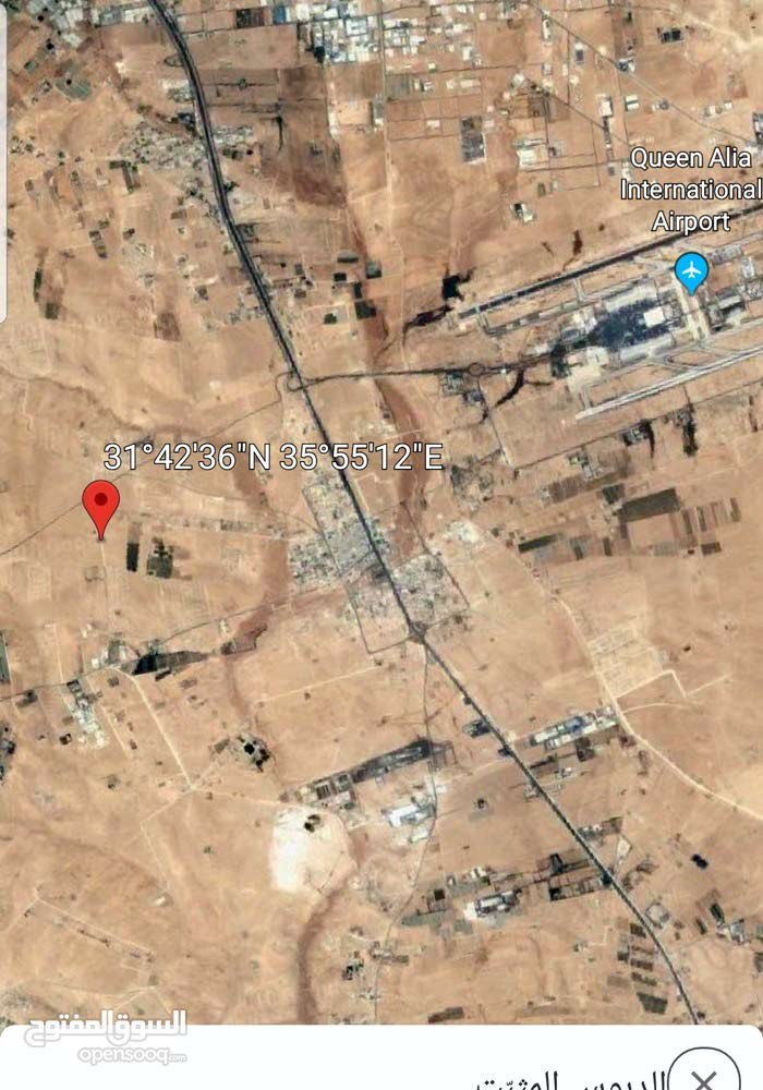 ارض للبيع 4 دونم مقابل المطار واصل الخدمات بجانب مشاريع مرتفعه