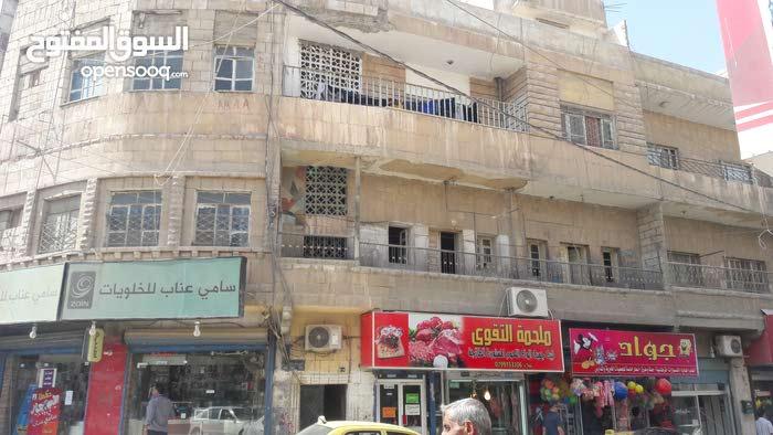 عماره استثماريه للبيع الغويريه شارع الملك غازي