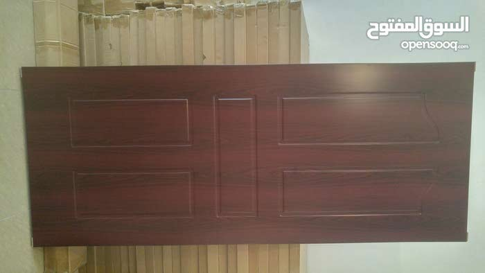 أبواب خشب جديدة بالقفص (تم تخفيض السعر)