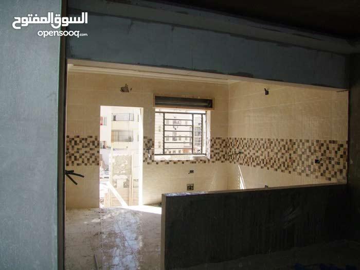 شقق قيد التشطيب للبيع في ضاحية الحاج حسن قرب البنك العربي مساحة 125 متر