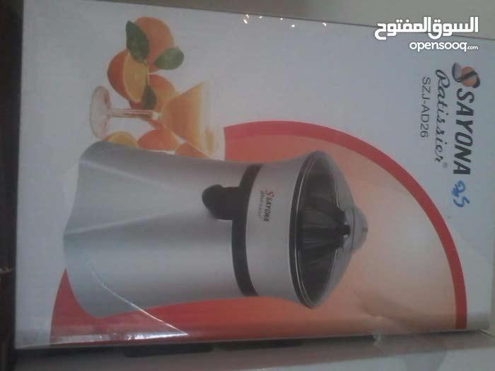 ماكينة عصير برتقال كهربائية بـ 50 فقط (( بعد التخفيض   )) تصفية محل