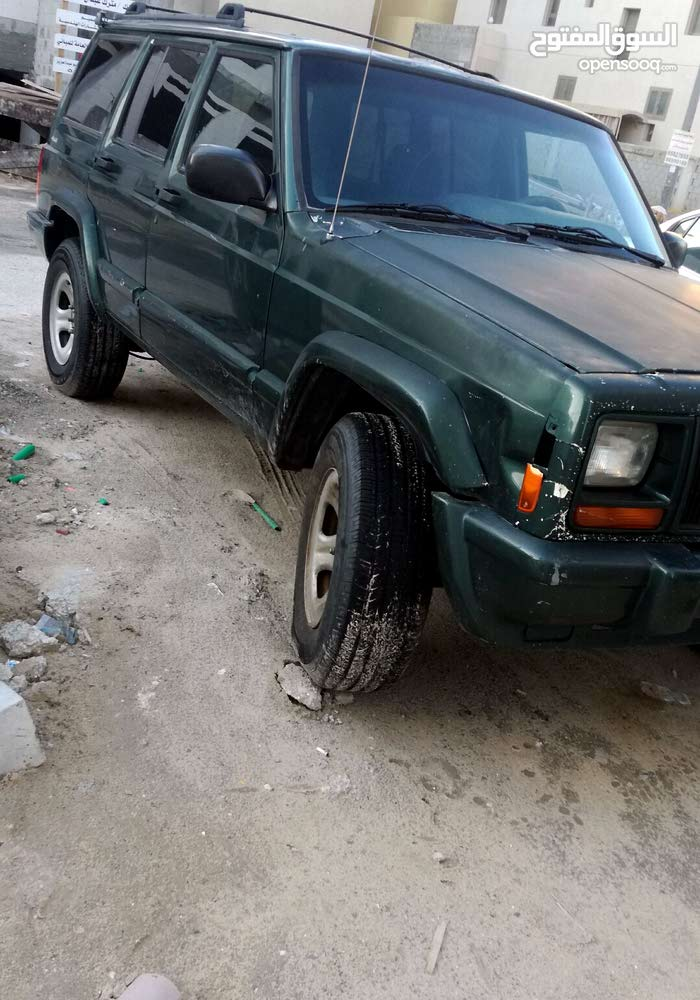 For sale 2000 Green Cherokee