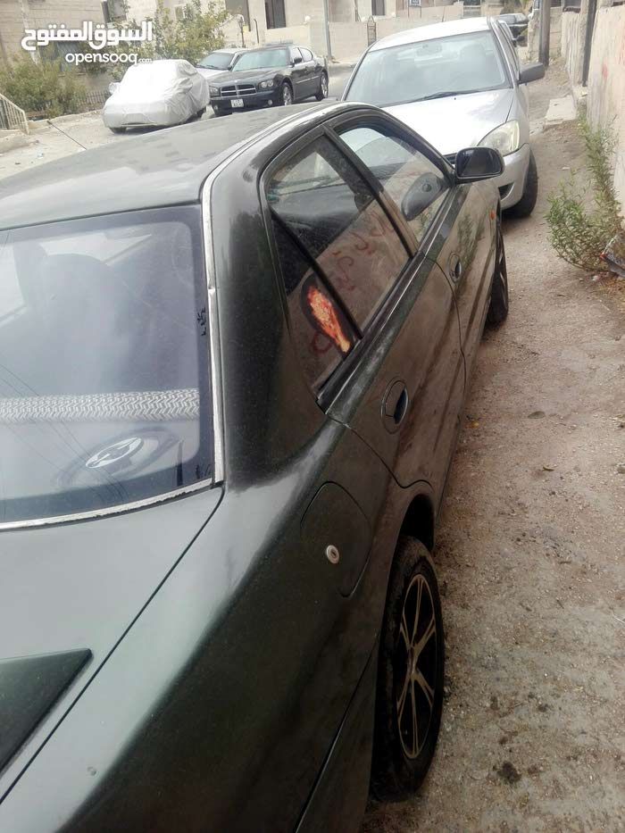 Used condition Mitsubishi Lancer 1993 with +200,000 km mileage