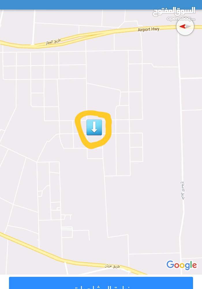 ارض بالقرب من جامع الالباني بها شهادة عقاريه طريق المطار في شارع الطيب الصافي