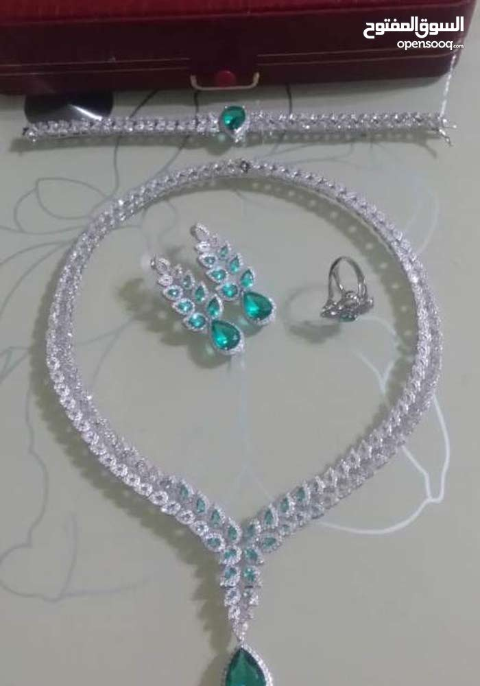 Set of Necklace, earrings, bracelet and ring