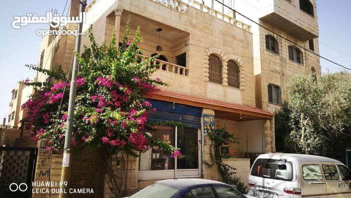 بيت مع محل تجاري مستقل للبيع