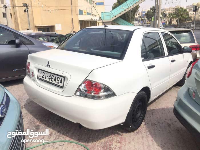 متسوبيشي لانسر 2011 لون ابيض  1300cc للبيع بسعر مميز