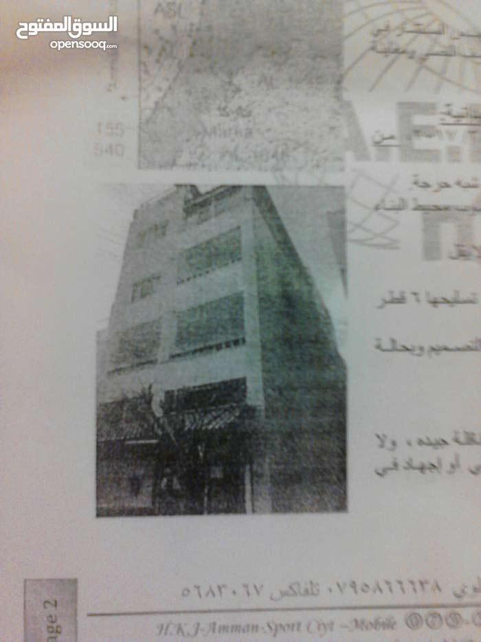 عماره مكونه من 4 شقق ومحل  اوتستراد