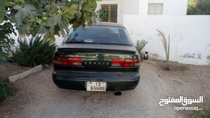 كيا سيفيا موديل ال 1997 لون اخضر زيتي للبيع
