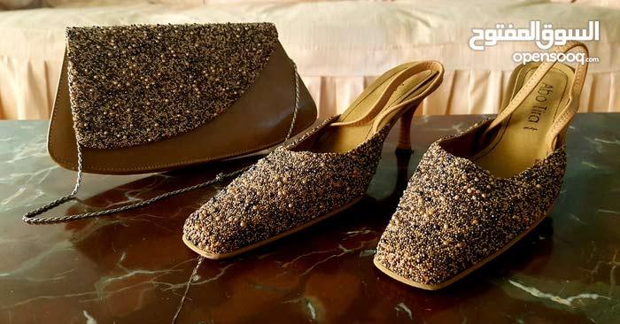 طاقم حذاء و شنطة للسهرة فى حالة ممتازة لم يستعمل إلا مرة واحدة