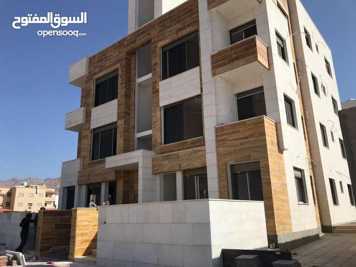 شقة 106م للبيع في العقبه منطقه النخيل