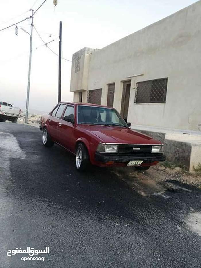 تويوتا كورولا DX متور 1300 معاها ترخيص سيارة ماشاء الله عنها مش ناقصها اشي دهان