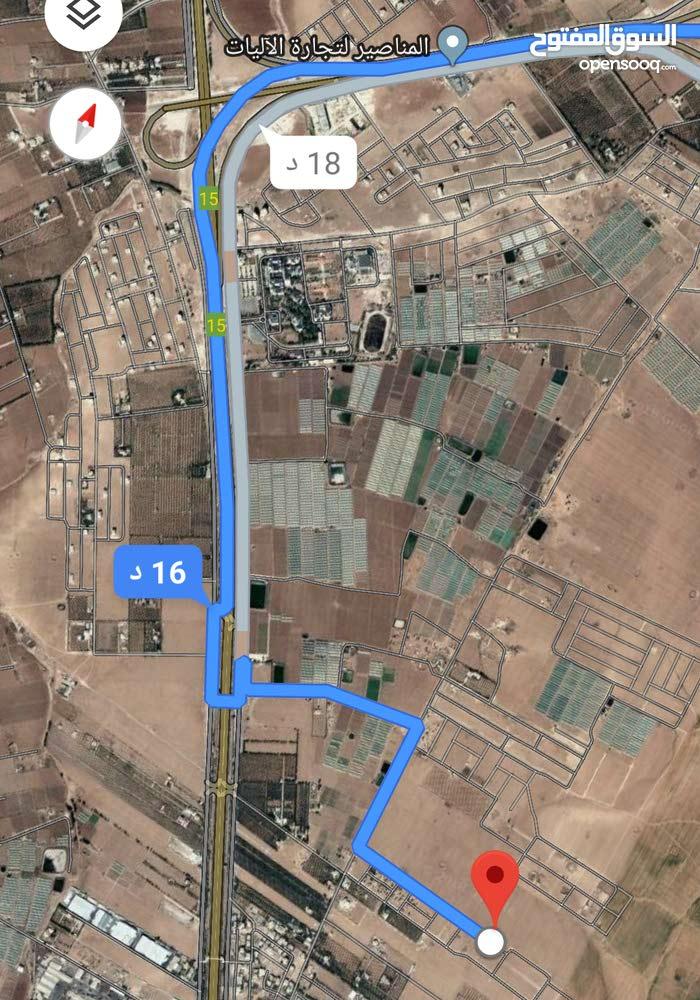 للبيع ارض 609 م في الطنيب طريق المطار