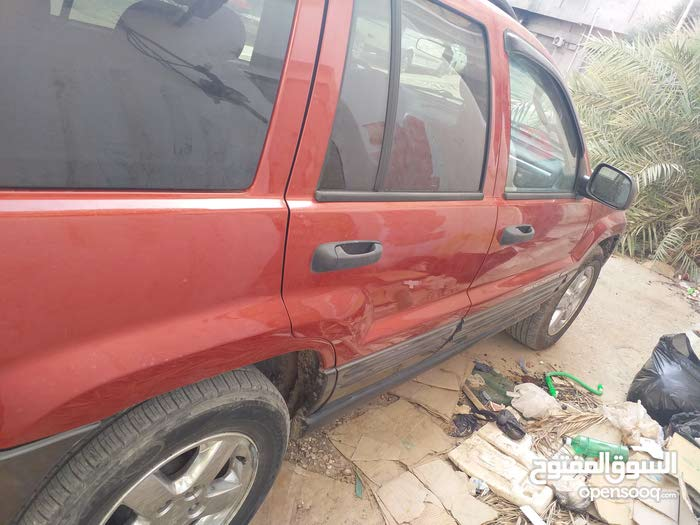 For sale 2004 Red Grand Cherokee