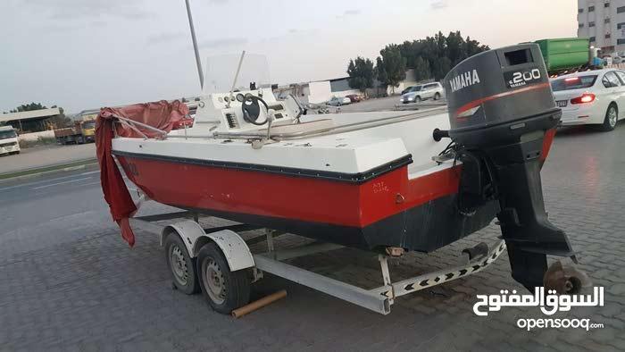 قارب 22قدم مع محرك وعربه للبيع