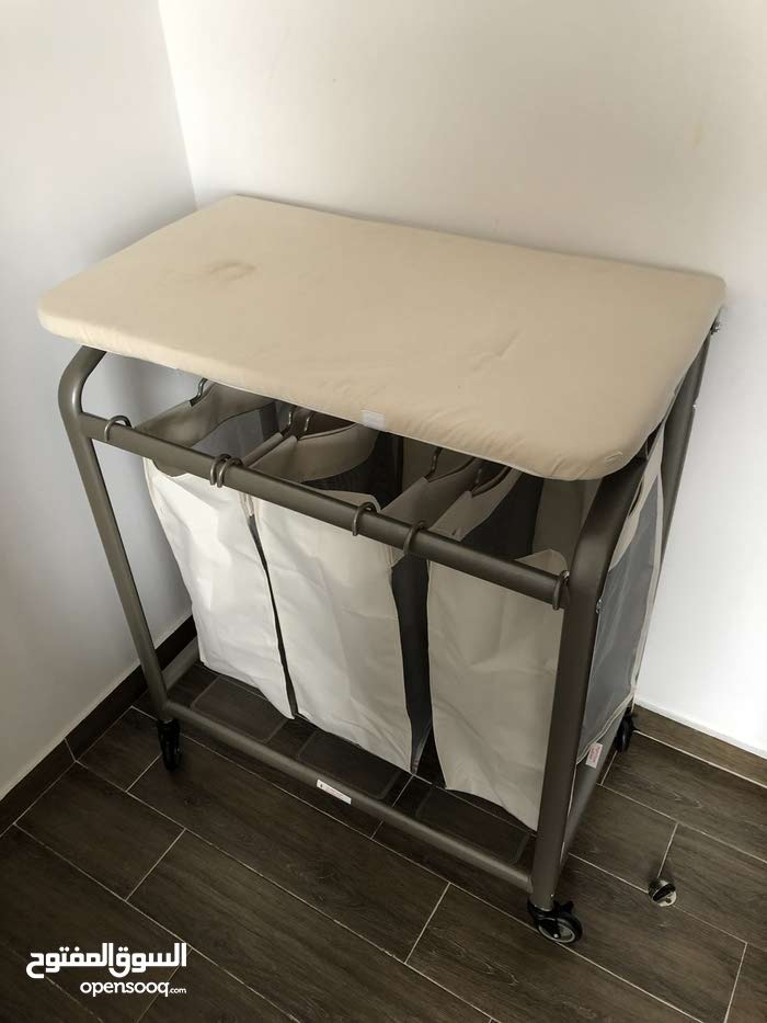 laundry basket with ironing board