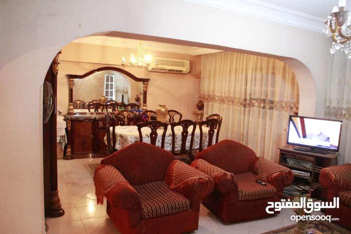 شقة 200 متر صافي بشارع بشارع جامعة الدول العربية