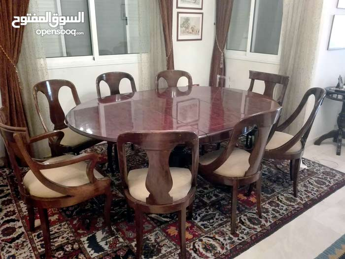 Dining table with 8 chairs and a vitrine