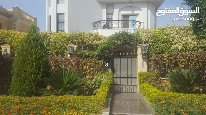 Extra super luxe villa for sale in a compound in sherook in Cairo