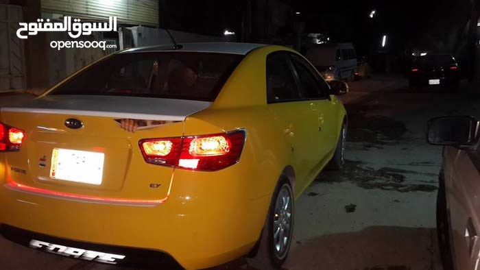 Yellow Kia Forte 2011 for sale