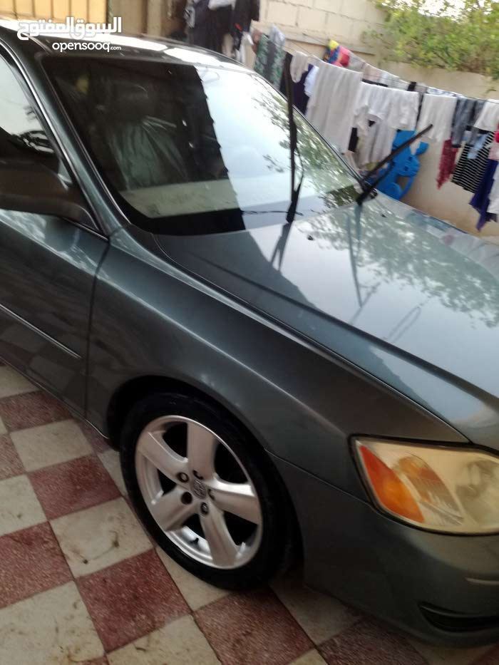 For sale 2000 Green Avalon