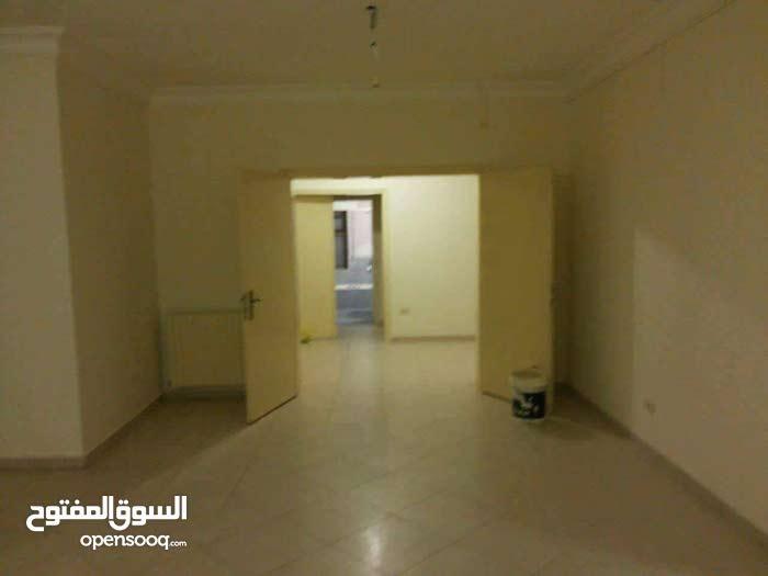 شقة ارضية طابقية ضاحية الرشيد م 245 متر