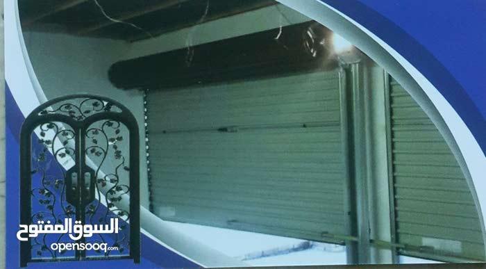 """ابو علاء """" بلال """" لتصليح جميع ابواب المحلات وتغيير دناجل الابواب العادية والكهرب"""