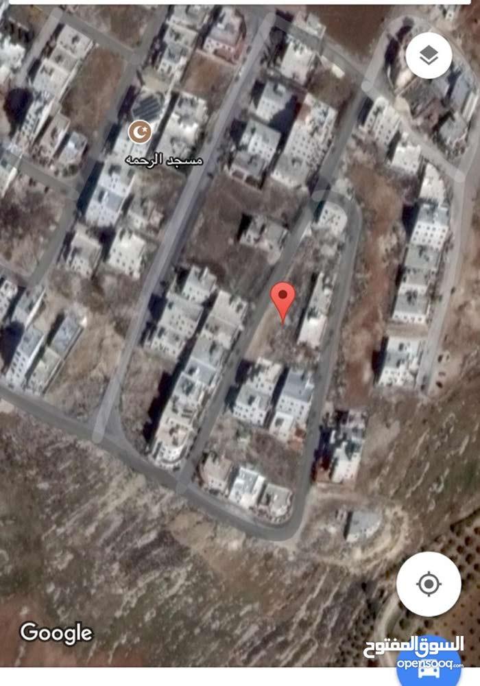 ارض 411م في البنيات اسكان الامانة شارع 16م مستوية مربعة